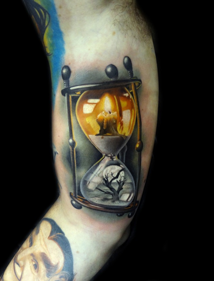Realistic hourglass tattoo with cadle and dry tree