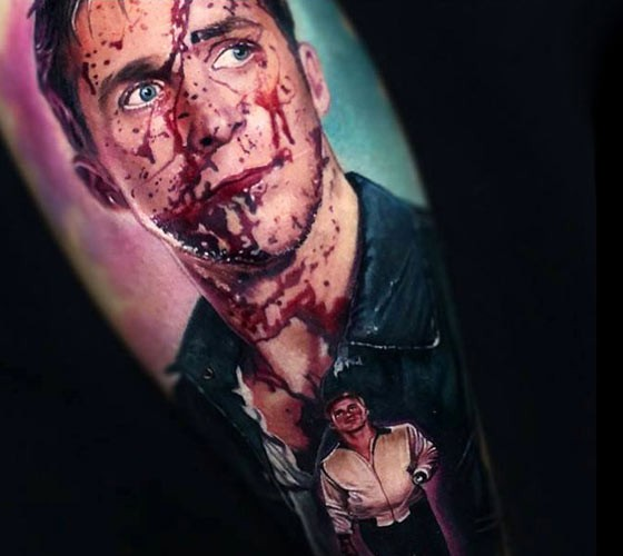 Realistic painted colored arm tattoo of bloody man portrait