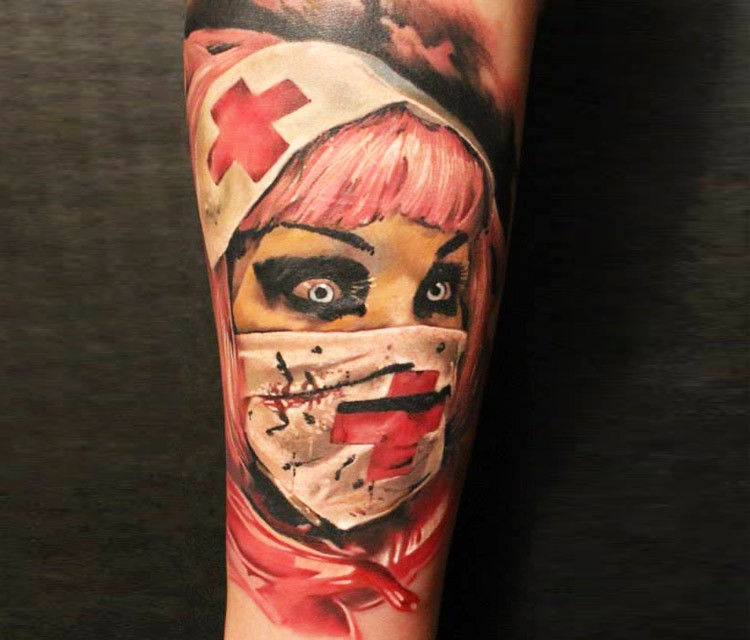 Realistic painted detailed bloody nurse tattoo on arm
