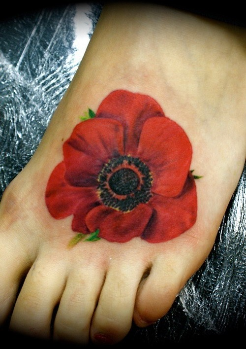 Realistic poppy flower tattoo on foot