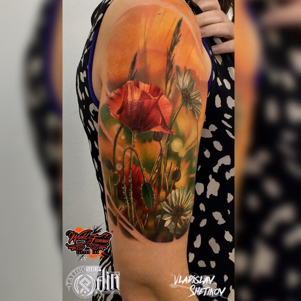 Realistic poppy flower tattoo on forearm