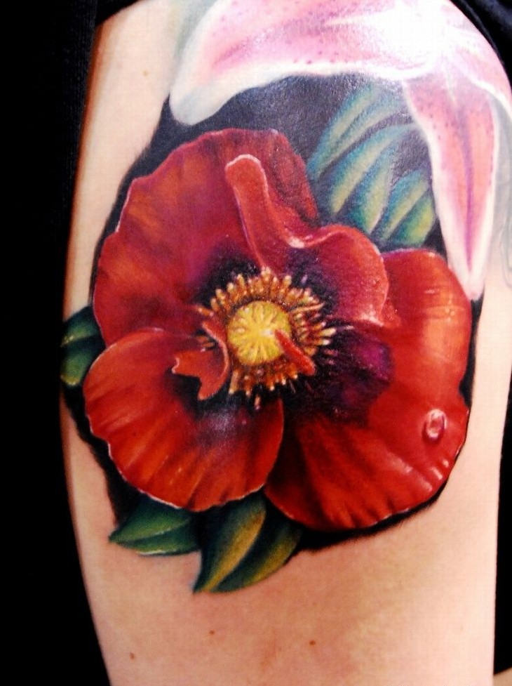 Realistic poppy flower with dewdrop tattoo on shoulder