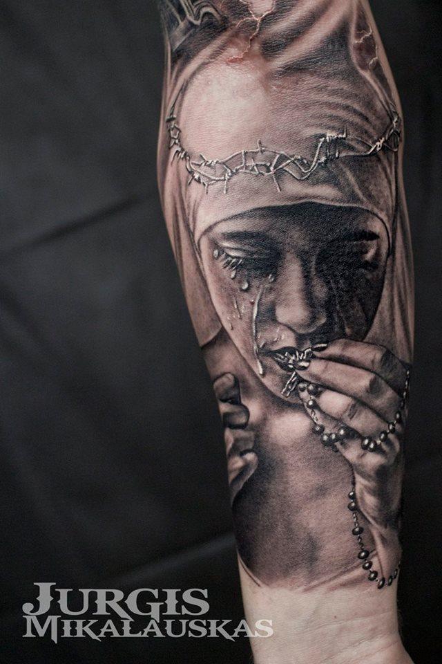 Realistic religious theme sleeve tattoo