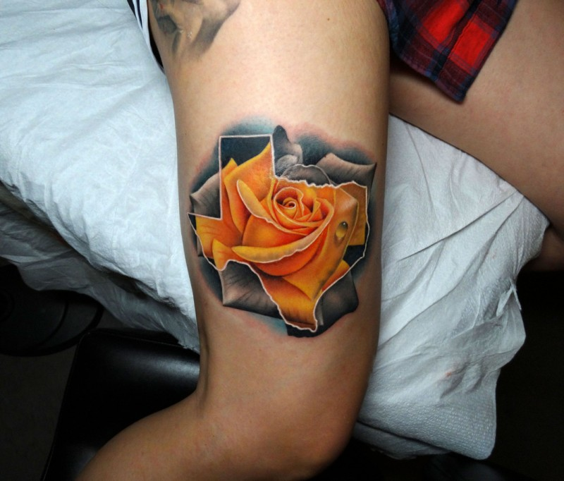 Realistic rose tattoo on arm