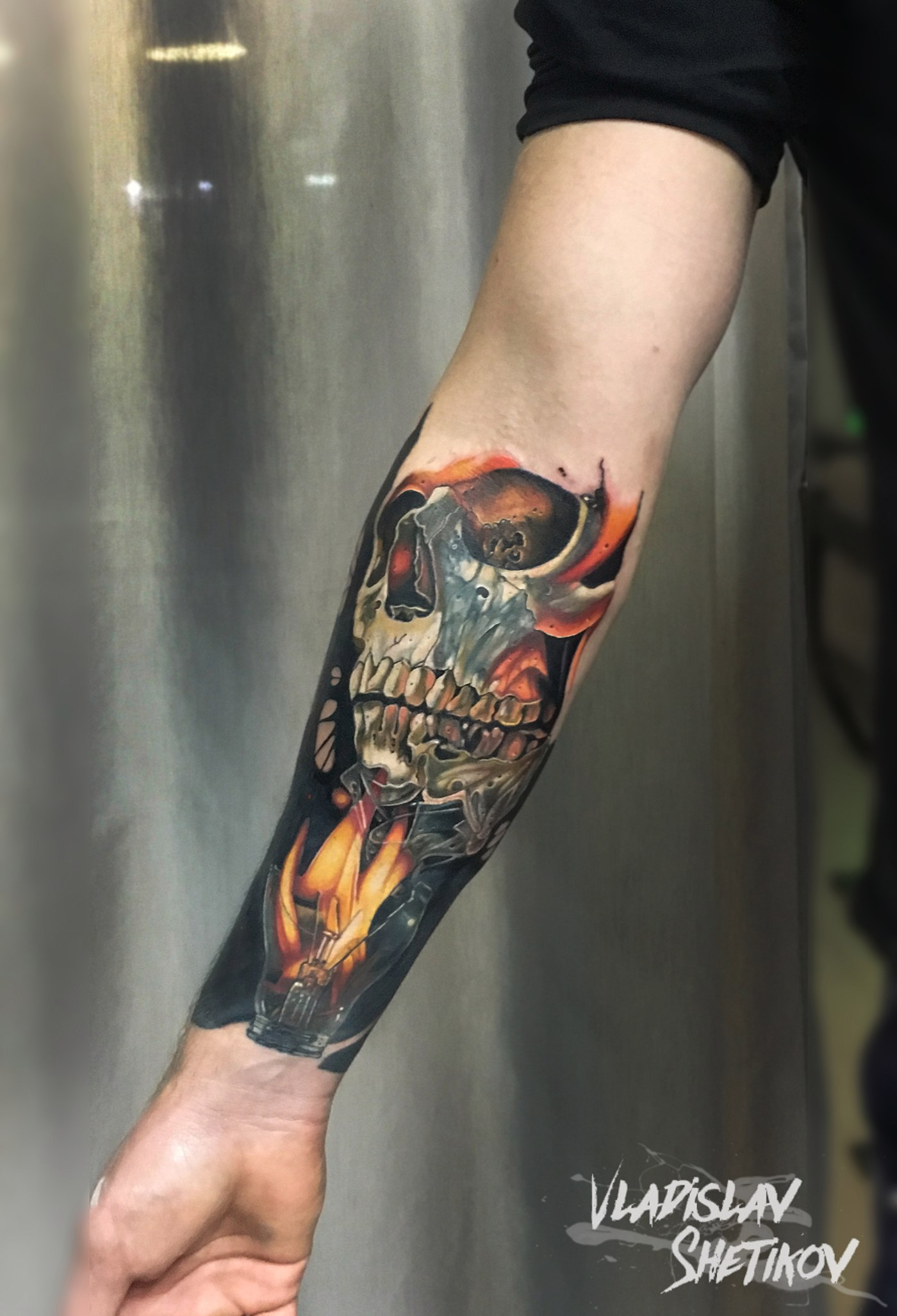 Realistic skull tattoo on forearm