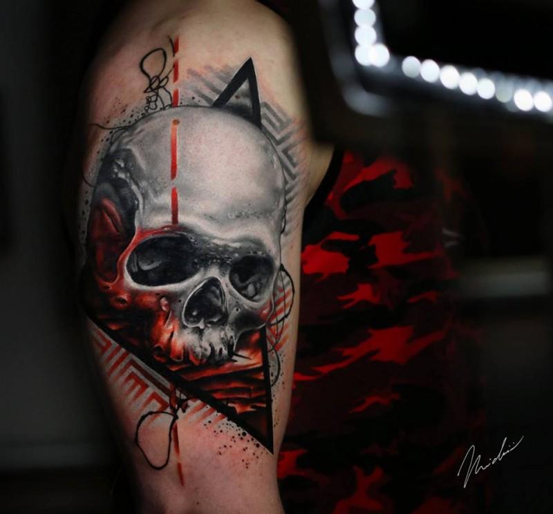 Realistic skull tattoo on shoulder