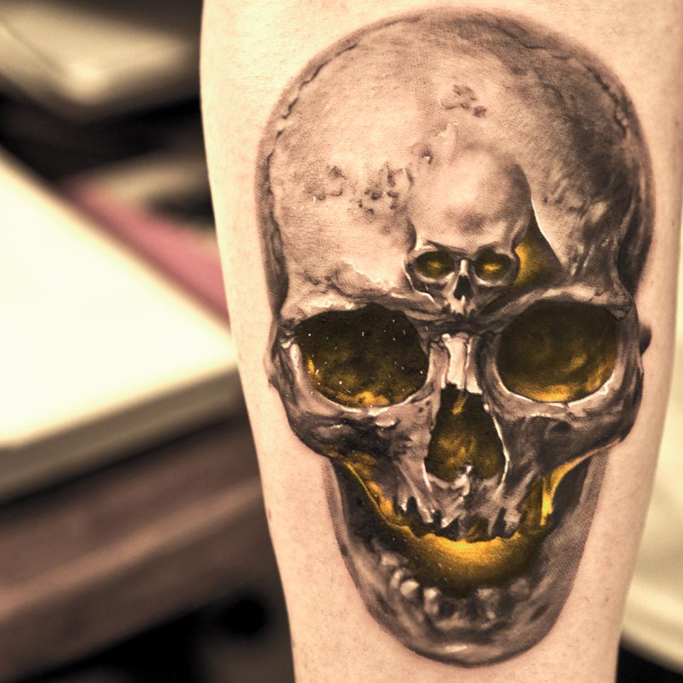 Realistic skull with small skull tattoo for men