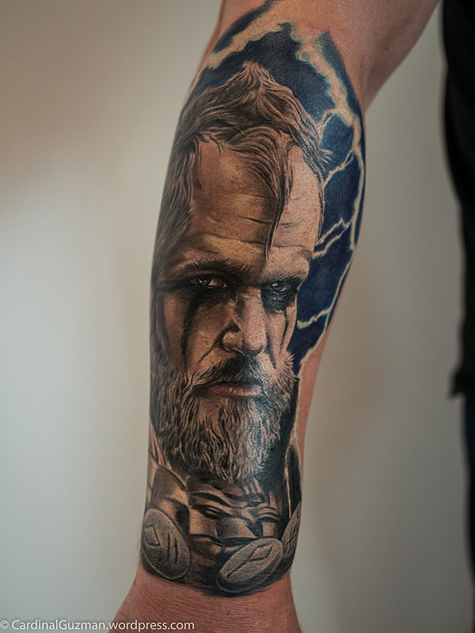 Realistic style colored forearm tattoo of viking by Cardinal Guzman