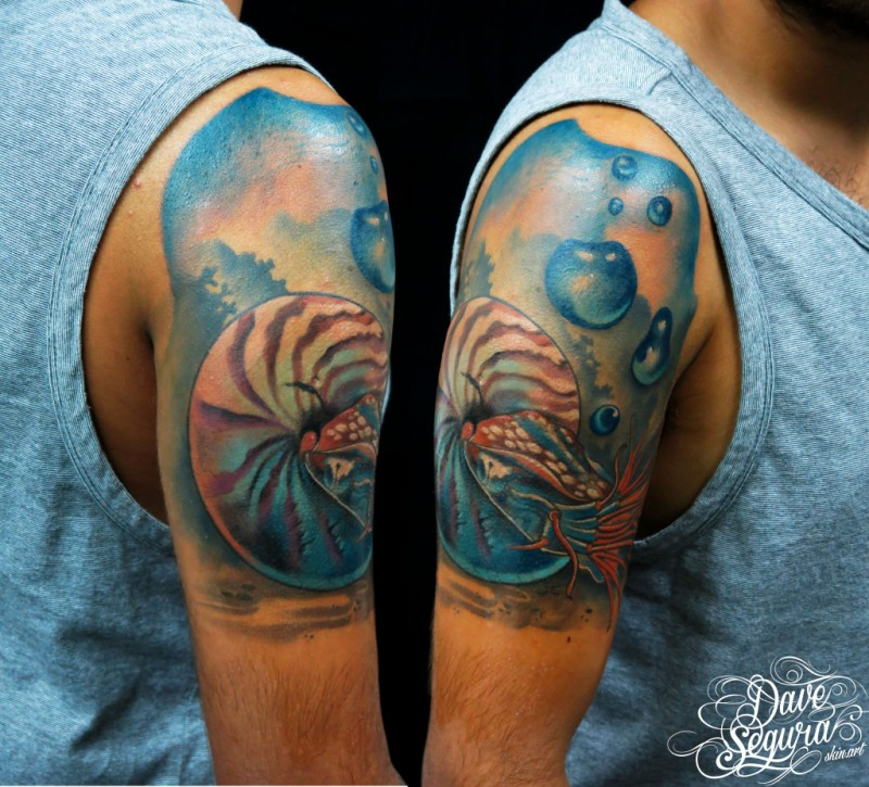 Realistic style colored upper arm tattoo of nautilus under water