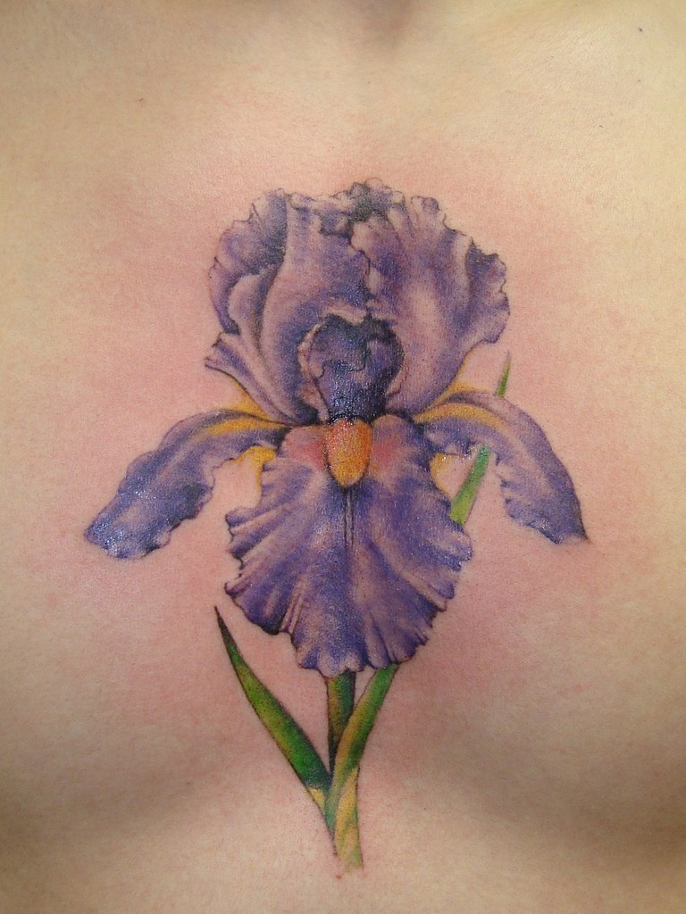 Realistic violet iris flower tattoo on chest