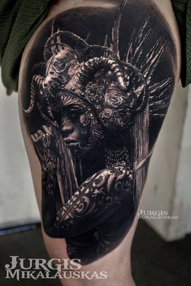 Realistic woman in hamlet tattoo on thigh