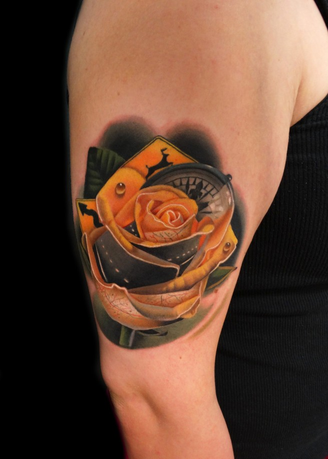 Realistic yellow rose tattoo with compas