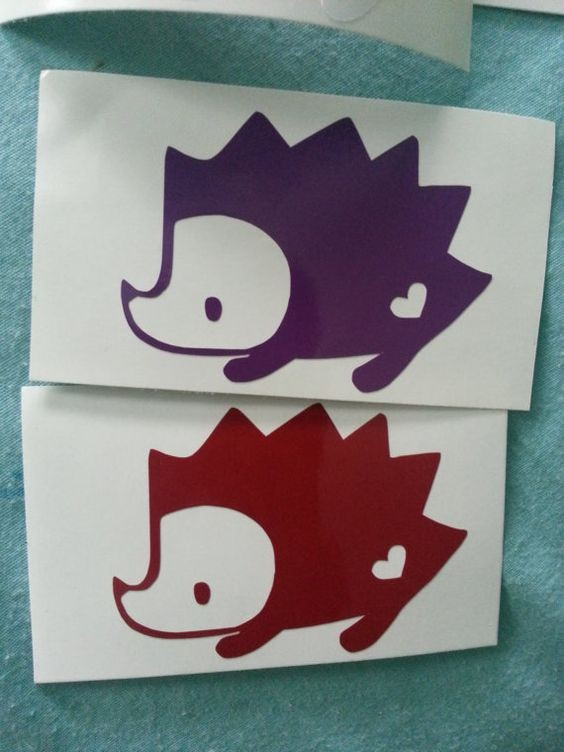 Red and purple hedgehogs with heart print tattoo design