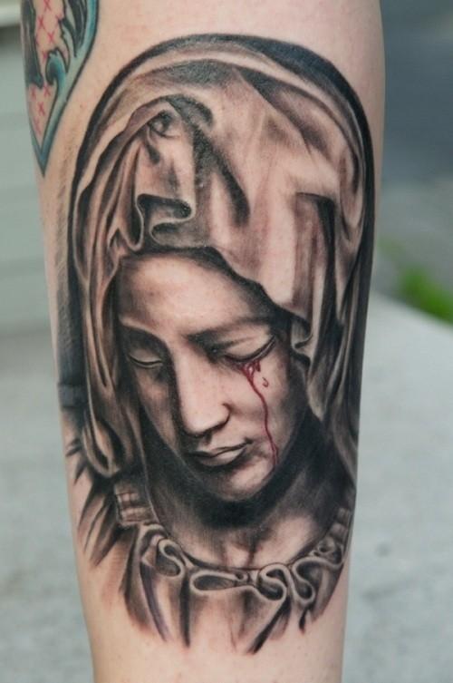 Religious black-and-white bleeding-eye Virgin Mary tattoo on forearm