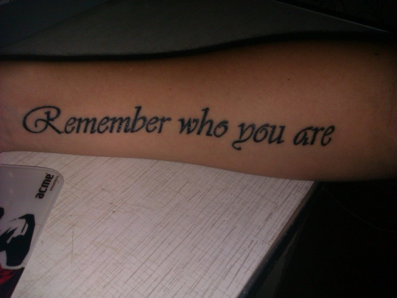 Remember who you are quote tattoo on arm