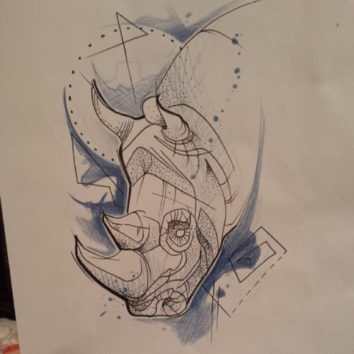 Rhino head with dotwork elements and blue coloring tattoo design