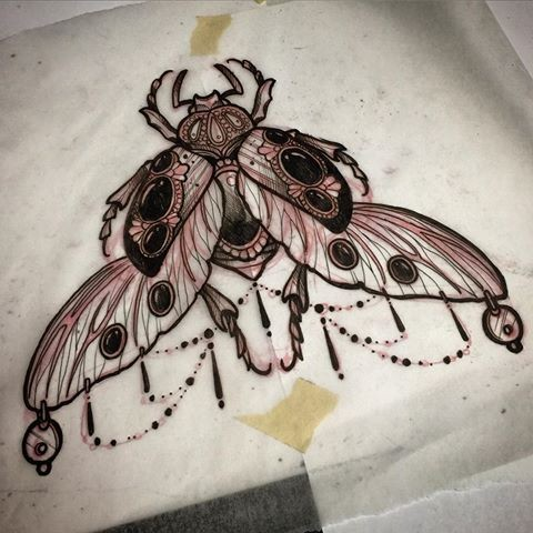 Rich black gem-decorated bug with hanging lace tattoo design