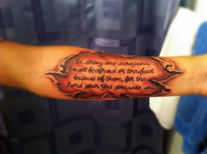 Ripped skin quote tattoo on arm