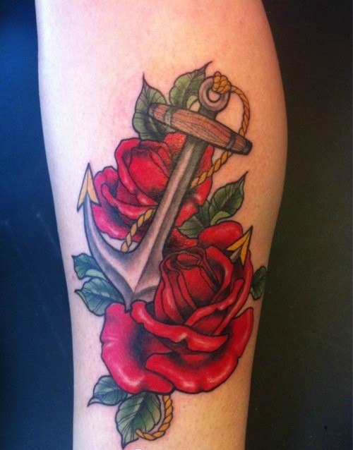 Romantic anchor in red roses tattoo on forearm