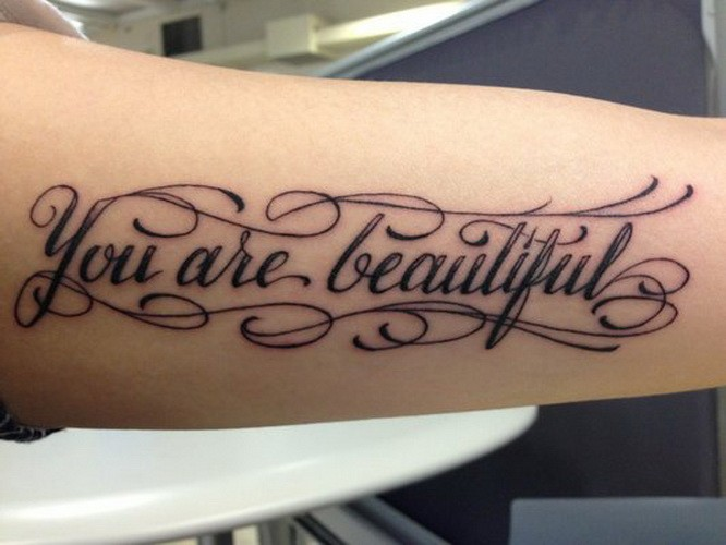 Rousing you are beautiful quote tattoo on arm