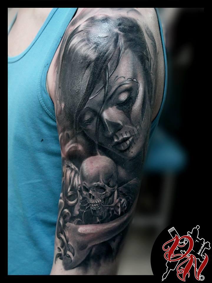 Santa muerte and skeleton tattoo on shoulder