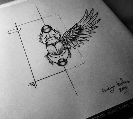 Scarab bug with one wing keeping ball with geometric drawings tattoo design