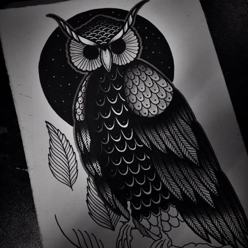 Scary black-eyed owl on black moon background tattoo design