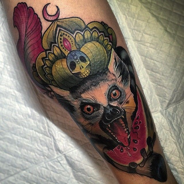 Scary crying lemur tattoo for men on arm