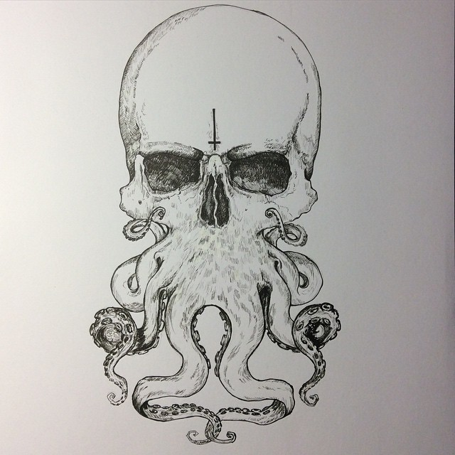 Scary skull-headed octopus with reversed cross tattoo design