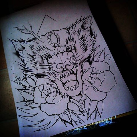 Screaming wolf head with roses and arrow tattoo design
