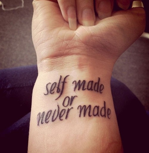 Self made or never made quote tattoo on arm