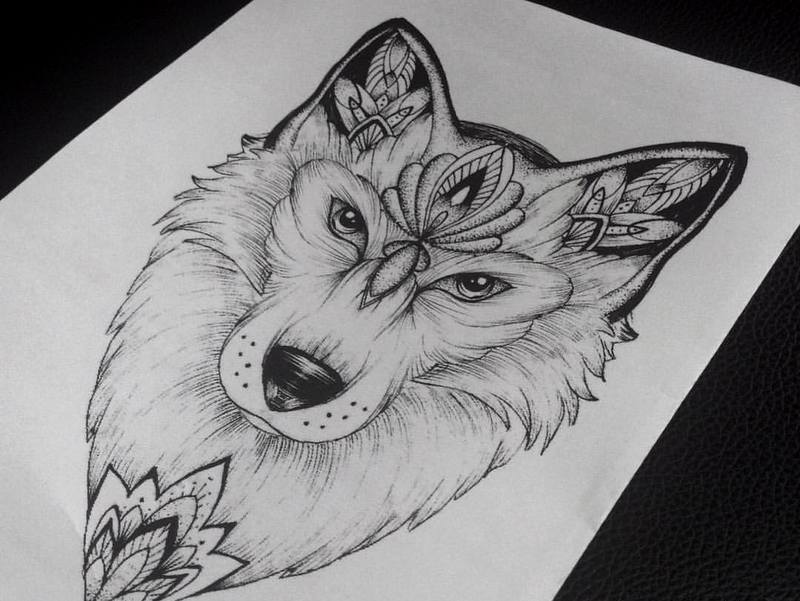 Severe wolf head with floral pattern tattoo design