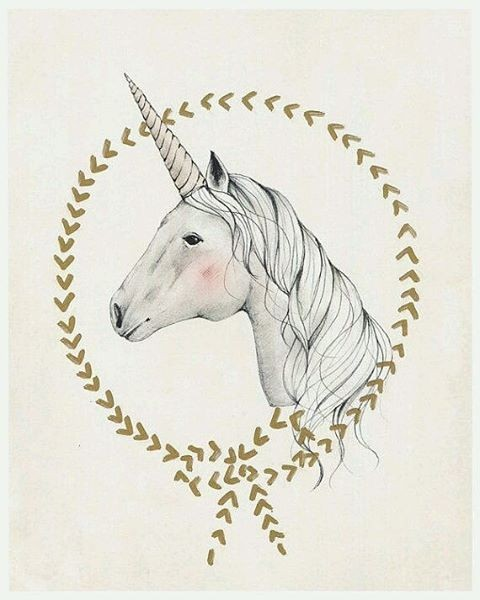 Shy rosy-cheeked unicorn in arrow frame tattoo design
