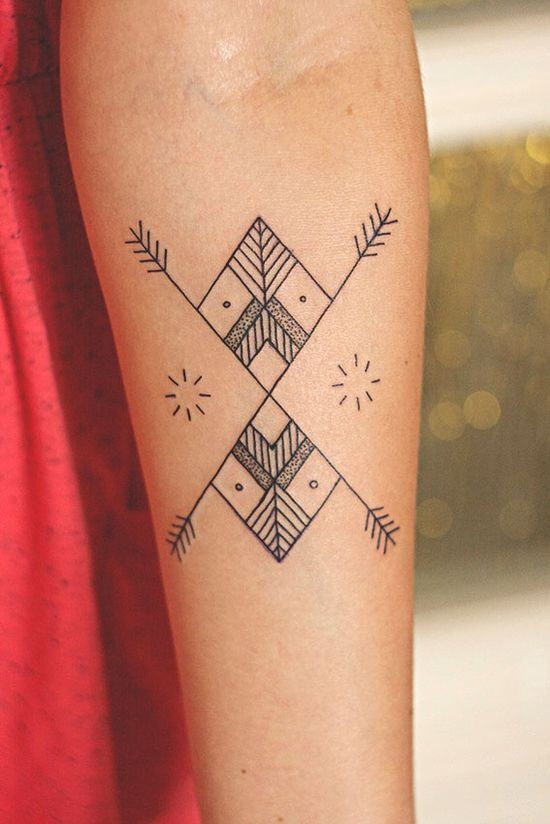 Simple black-and-white ornamented tattoo on forearm