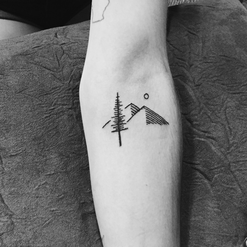 Simple black-ink tree with heels and moon tattoo on forearm
