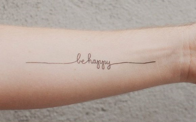 Simple elegant be happy quote tattoo for women on arm