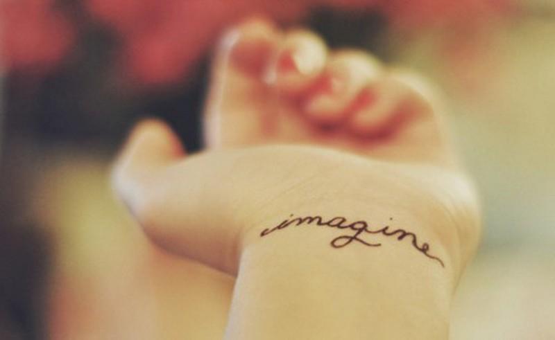 Simple elegant imagine quote tattoo for women on arm