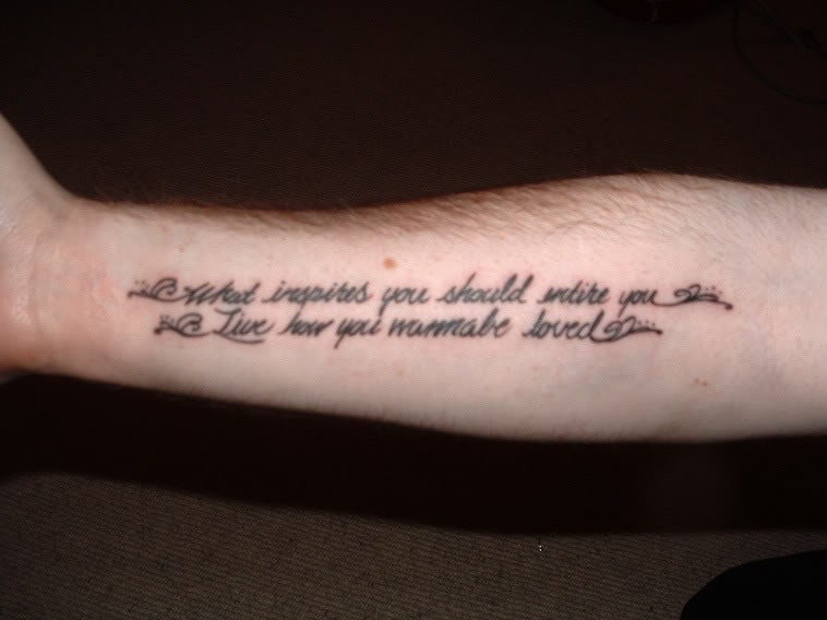 Simple two-lined quote tattoo on arm