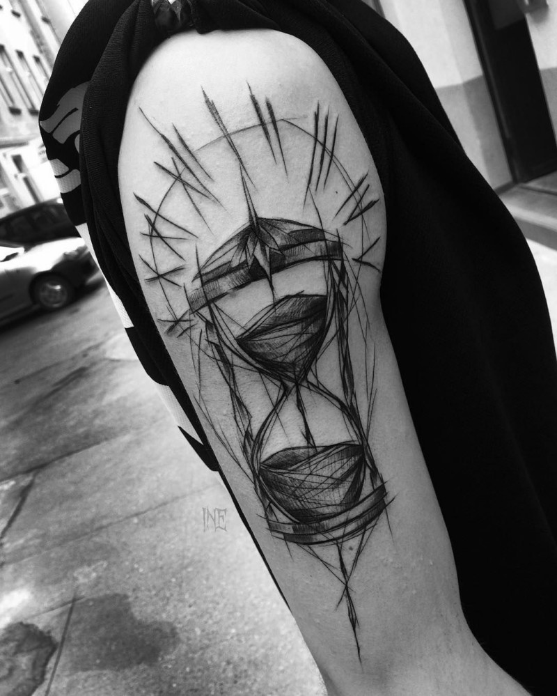 Sketch style hourglass tattoo on arm