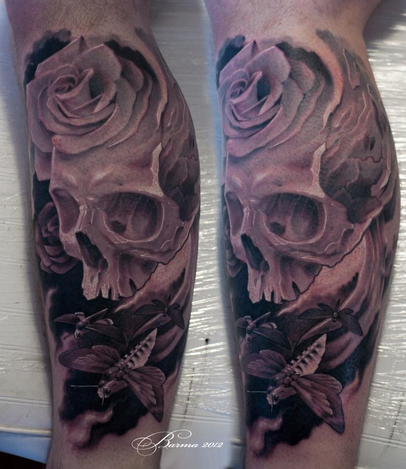 Skull, moth and rose tattoo on leg