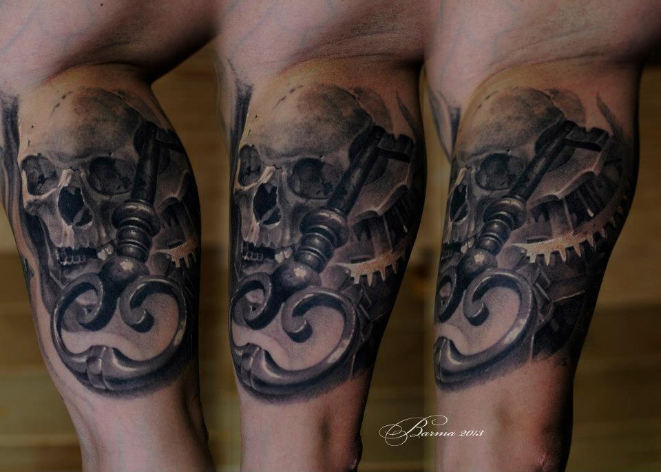 Skull and key tattoo on arm