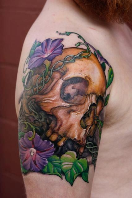 Skull and primrose flowers tattoo on shoulder