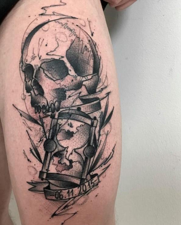 Skull with hourglass tattoo by Przemek Marcisz
