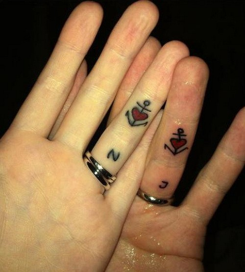 Small black anchors with red hearts for sweethearts tattoo on fingers