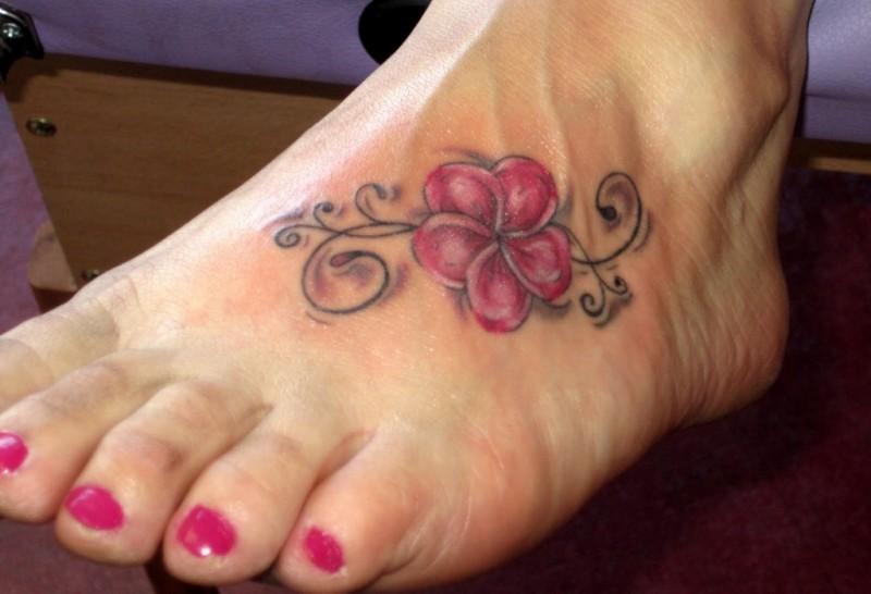 64962d5cf Small colorful hawaiian flower tattoo on foot - Tattooimages.biz