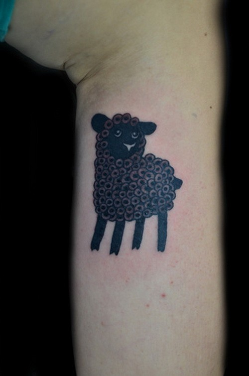 Small dark curled-fur sheep tattoo on arm