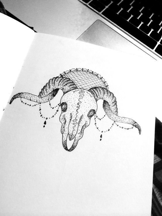 Small dotwork ram skull with lace decoration tattoo design