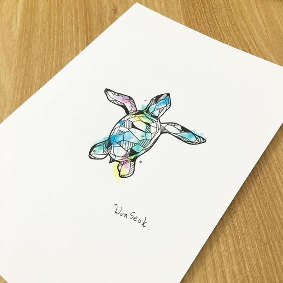 Small geometric turtle on rainbow watercolor background tattoo design