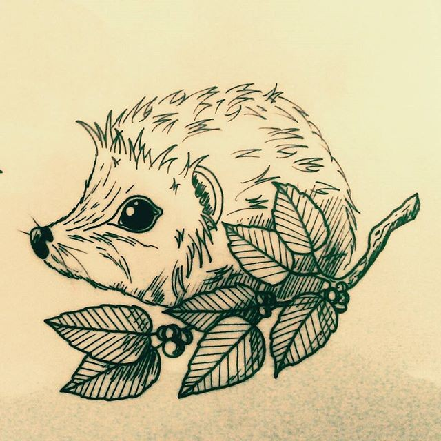 Small outline hedgehog and berried branch tattoo design