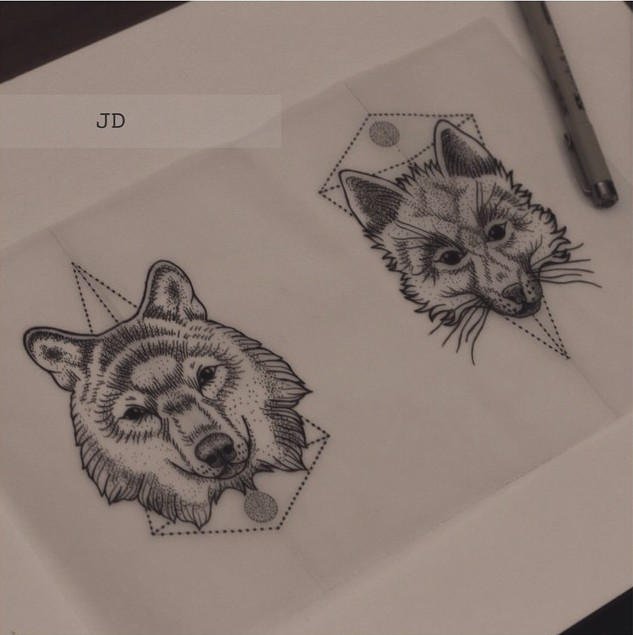 Small wolf heads with geometric drawings tattoo design
